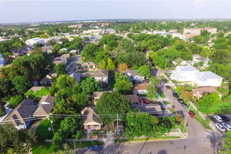 An aerial view above a Houston neighborhood.