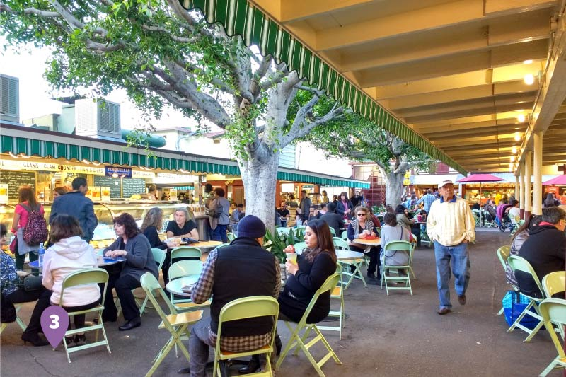 People eating at the Original Farmers Market.