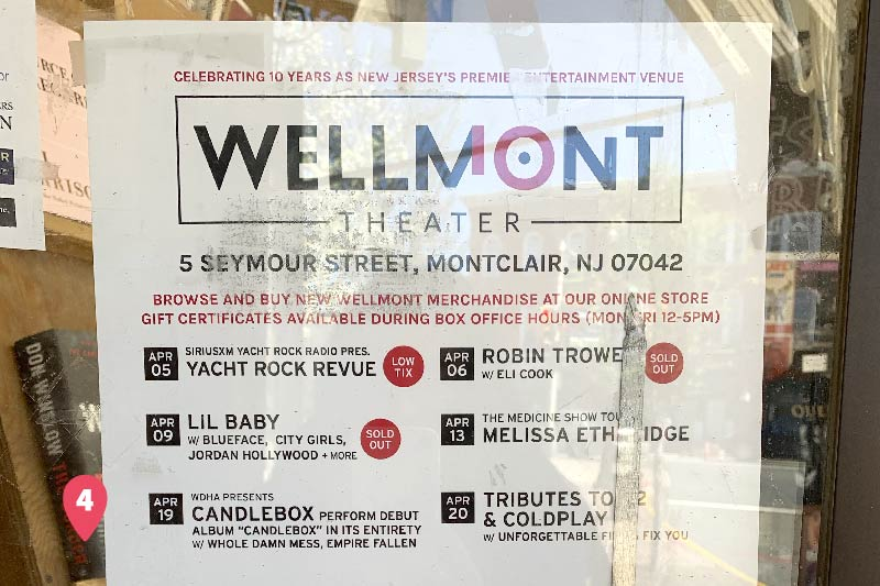 A sign on the front door of the Wellmontt Theater detailing upcoming shows.