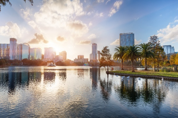 Sunset at Orlando in Lake Eola Park with water fountain and city skyline, Florida, USA  Z