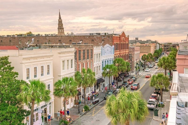 A busy street lined with palm trees in the heart of Charleston South Carolina
