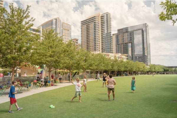 People enjoying Klyde Warren Park in downtown Dallas.