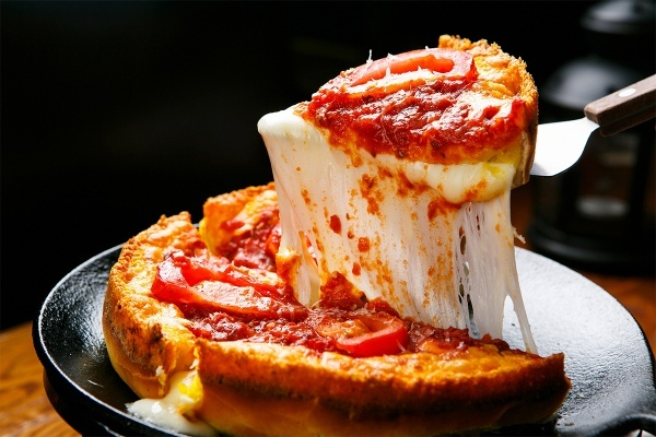 The History Behind Chicago Deep Dish Pizza, and Where to Find the Best Pies