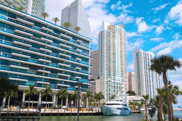 A view of multiple luxury condos along Miami's riverfront.
