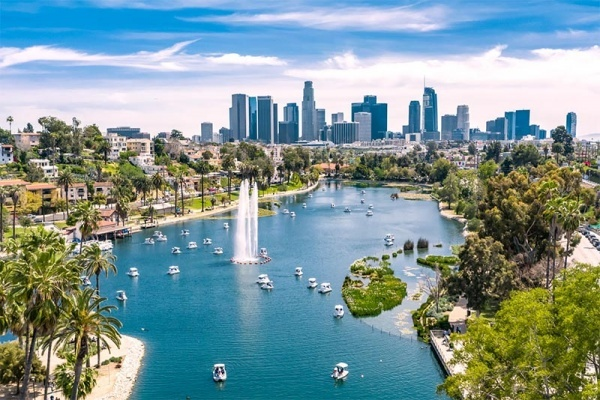 An aerial view of the Downtown Los Angeles skyline from the pond at Echo Park