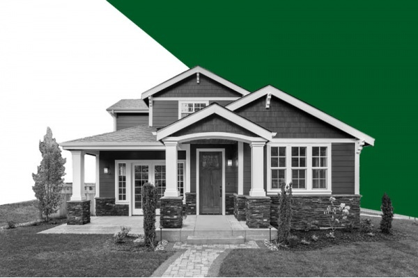 A home in black and white against a background that is half white half dark green