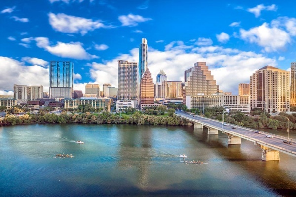 The Austin skyline against the blue sky and along the Colorado River
