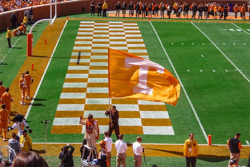 A man waves a Tennessee Volunteers flag in Knoxville