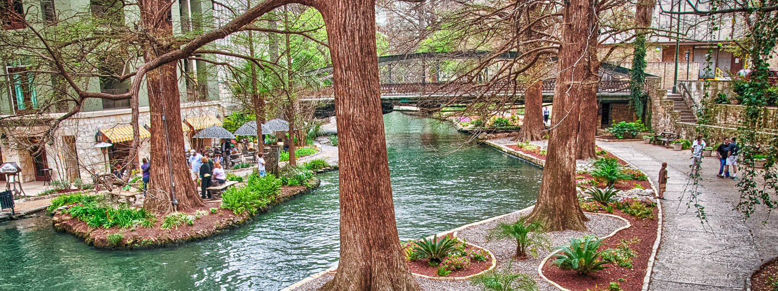 People walking around the San Antonio Riverwalk