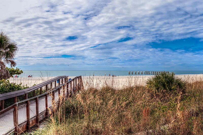 An image of a bridge that leads to a beachfront and ocean views in Boca Grande Florida