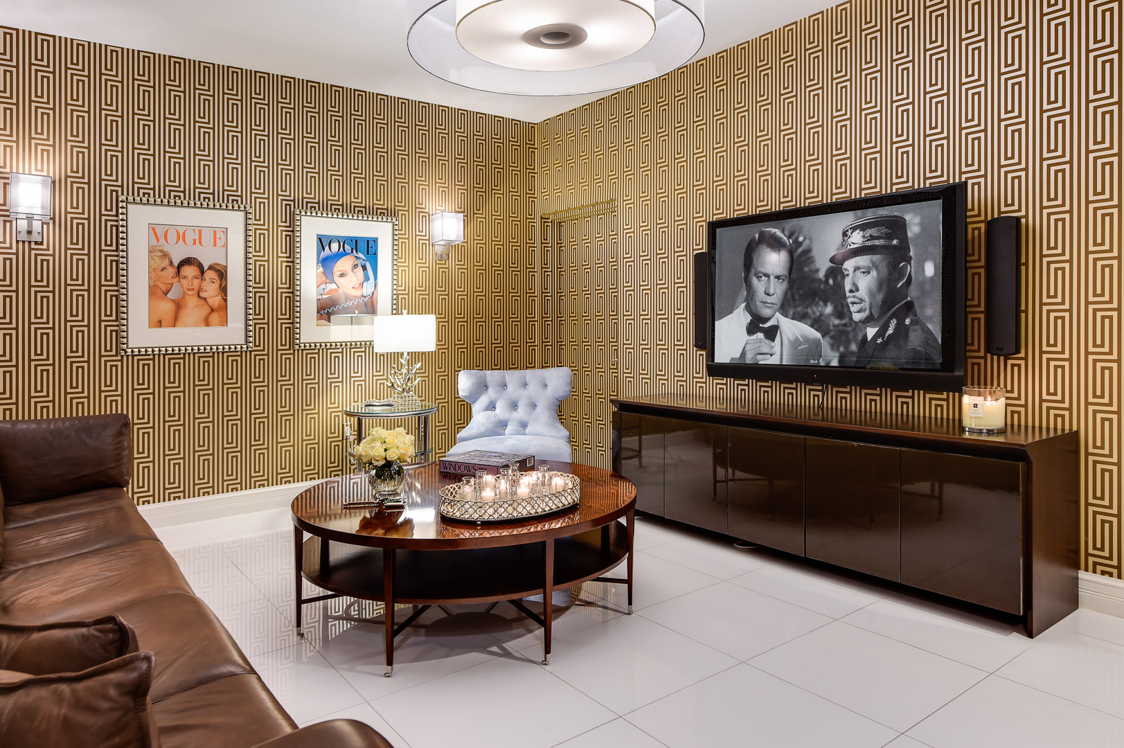 Interior of a luxurious living room with Humphrey Bogart's Casablanca on the TV.