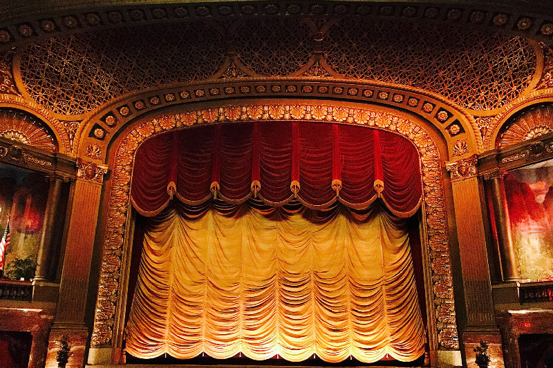 Inside of Byrd Theater looking at stage with curtain.