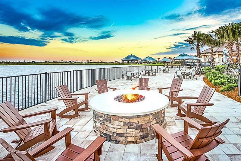 A fire pit along water in a community at Lakewood Ranch