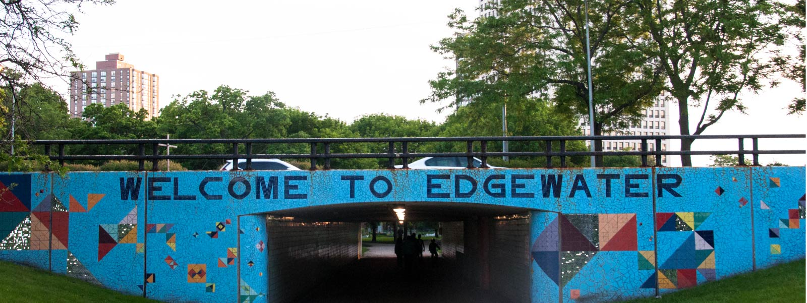 "A ""Welcome to Edgewater"" mural painted on the side of a pedestrian Lake Shore Drive underpass."