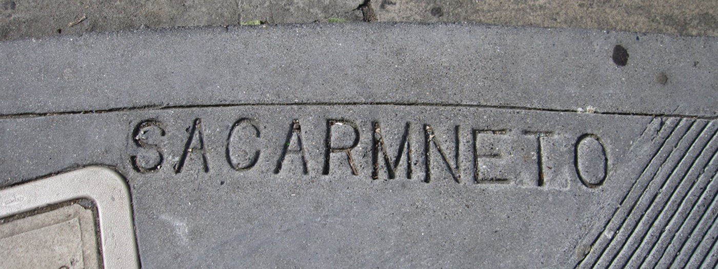 Why are so many street name typos stamped into San Francisco sidewalks?