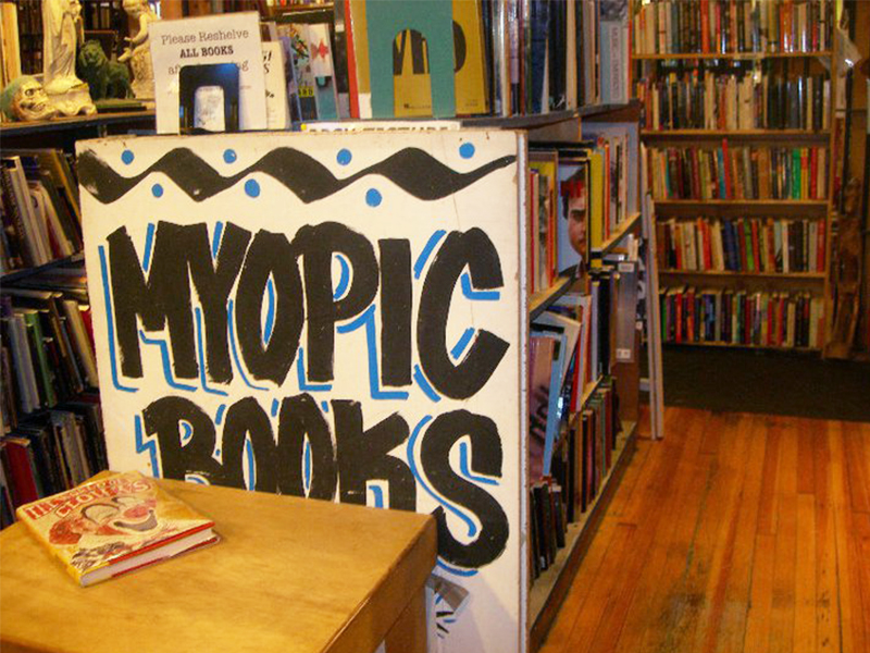 Sign for Myopic Books on the side of a bookshelf in Chicago's Wicker Park neighborhood