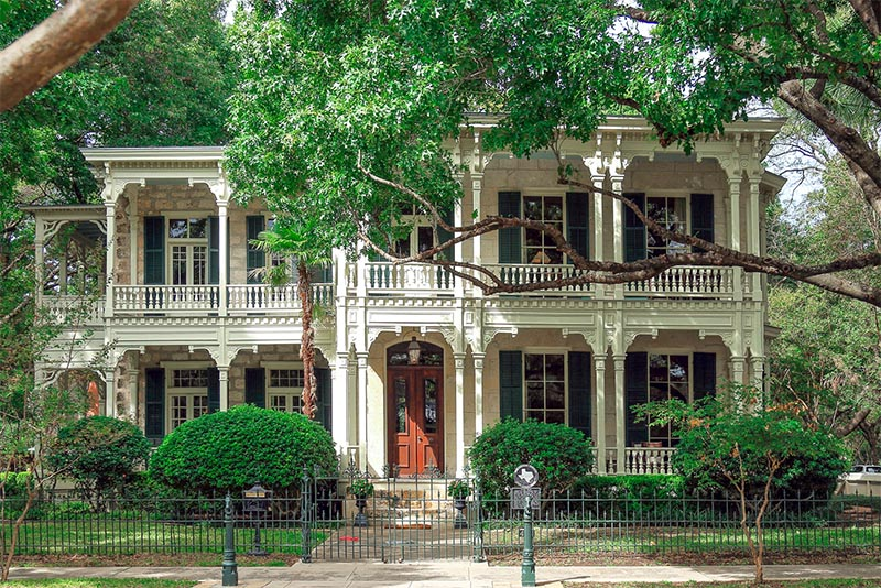 A historic white house sits in San Antonio's King William Historic District