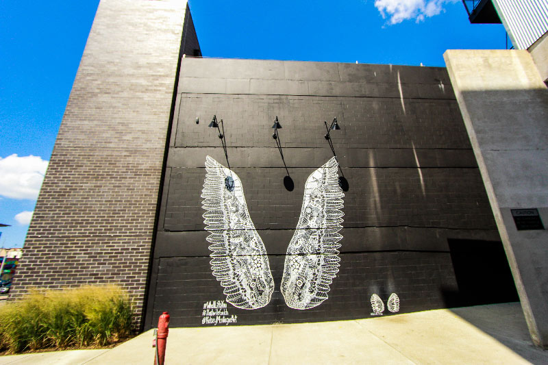 angel wings mural along apartment building