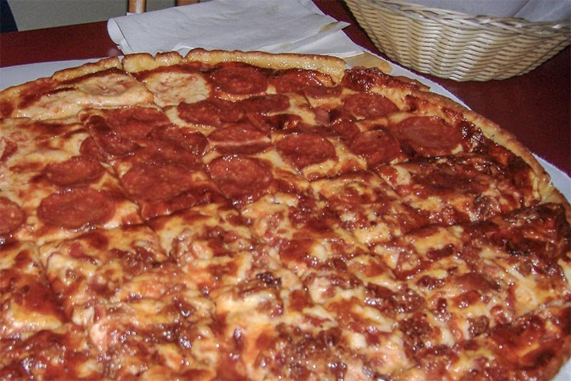 A Chicago tavern-style pizza with square-cut slices