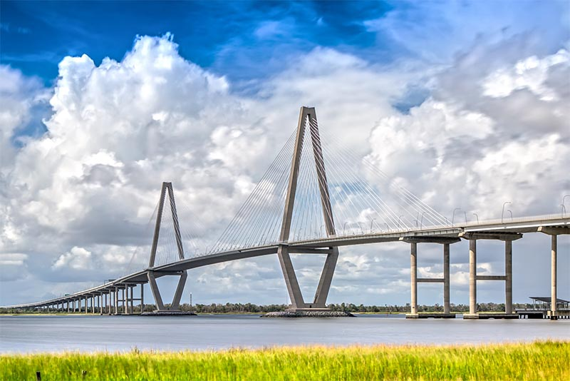 The Ravenel Bridge connecting Charleston to Mount Pleasant as seen from a grassy field