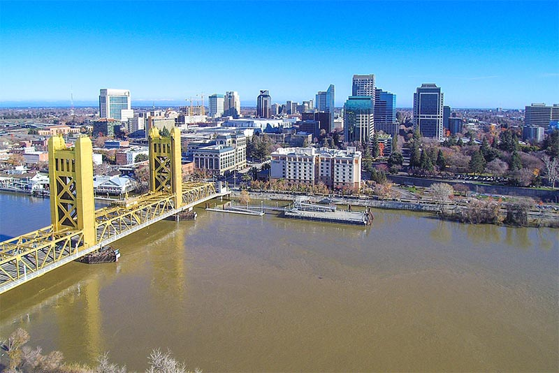 An aerial view of Sacramento with a view of the river and the skyline