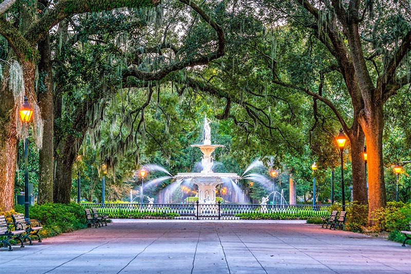 A large fountain surrounded by willow trees in Savannah Georgia