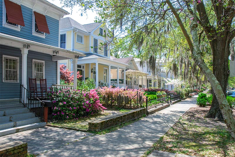 Historic homes along a tree-lined street in Wilmington, North Carolina