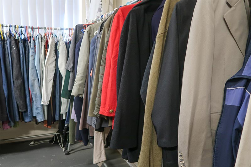Clothing on racks at a thrift store
