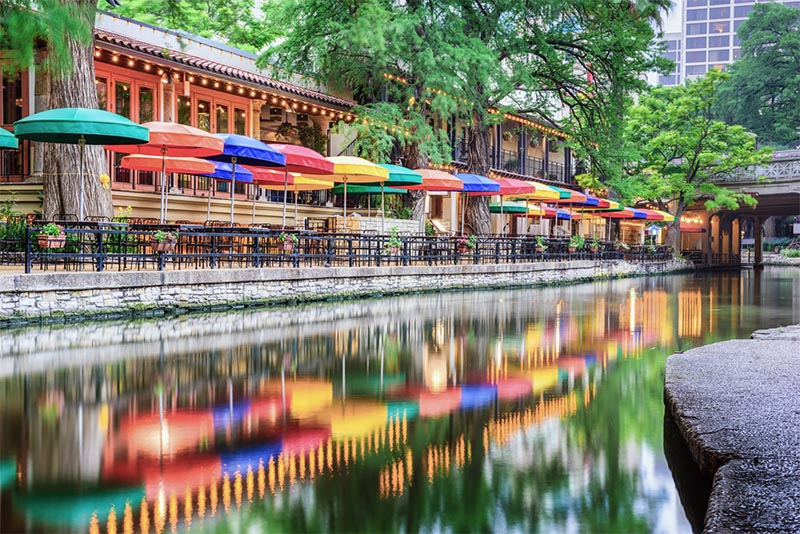 A row of umbrellas on the San Antonio Riverwalk