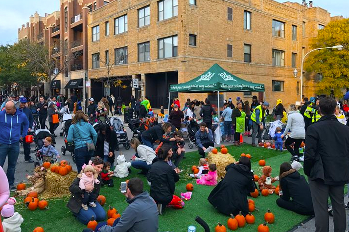 Many families outside celebrating Halloween at Trick-or-Treat on Southport in Chicago.