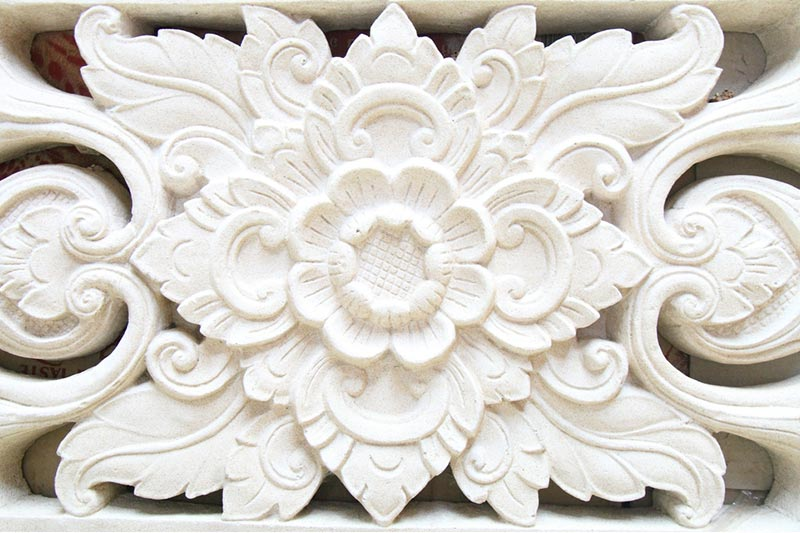 Intricate white stucco design in shape of flower