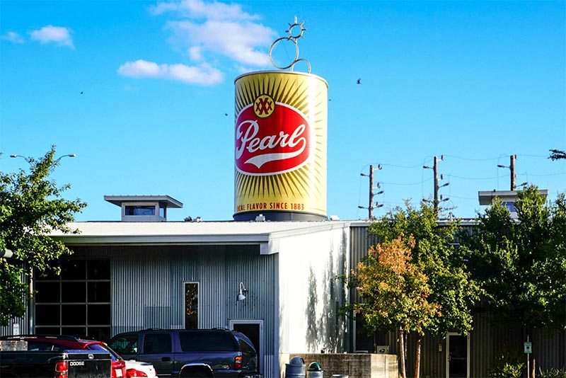 A sign shaped like a can for the Pearl Brewery in Tobin Hill San Antonio