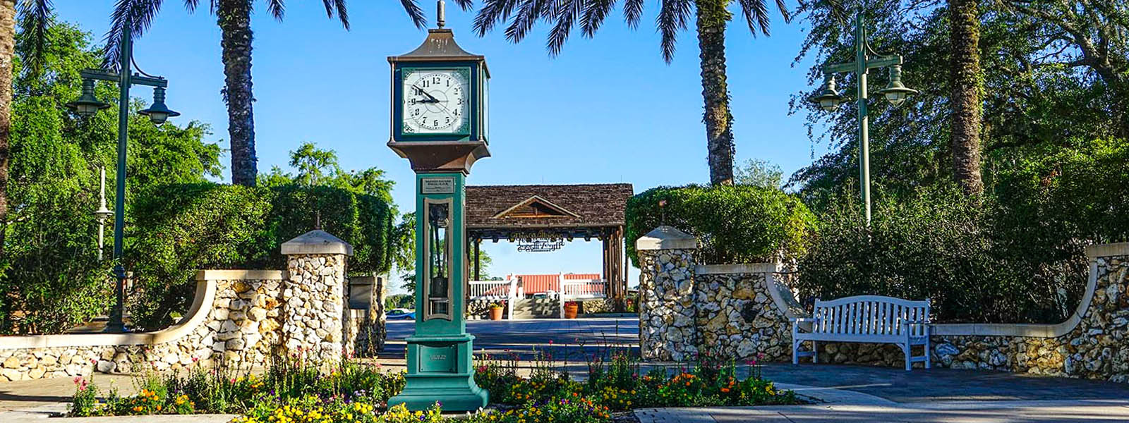 A clock in the center of a stone courtyard in The Villages Florida